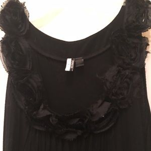 Black dress with rosettes